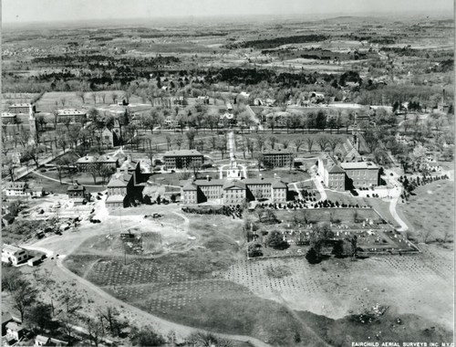 A black-and-white aerial photo of the Phillips Academy campus from the west, circa 1929. Samuel Phillips Hall and its adjacent buildings are centered.